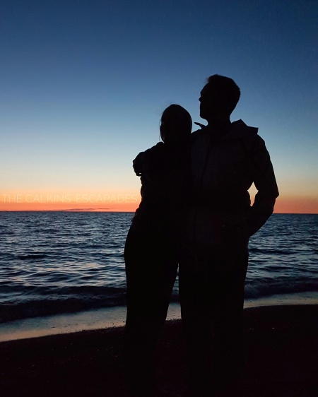 Couple silhouette at beach sunset